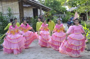 Dancers from the Sibaltan Elementary School perform for their visitors.