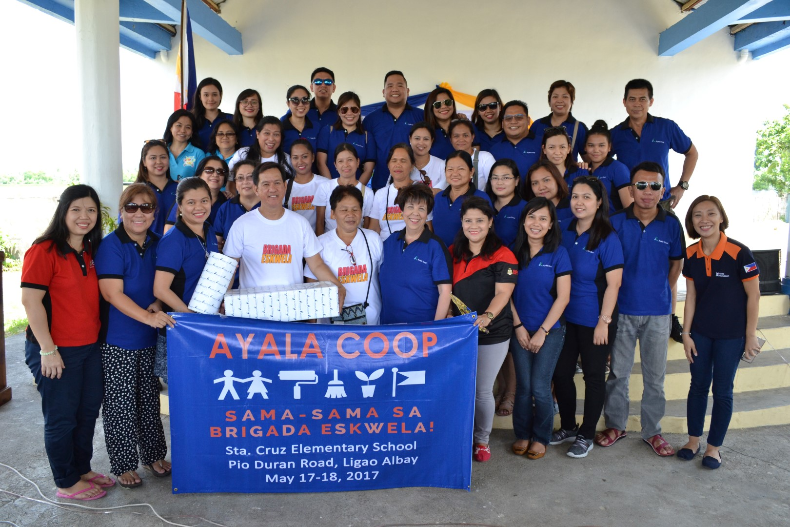 The Coop contingent led by General Manager Dina Orosa (front row, sixth from right) is shown with Sta. Cruz Elementary School officials led by its principal, Alan Alconera (fourth from left), after the welcome program for the Brigada Eskwela project at the school.
