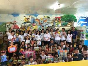 The Coop team is shown with Sta. Cruz Elementary School pupils during the turnover of the toy library to the school.