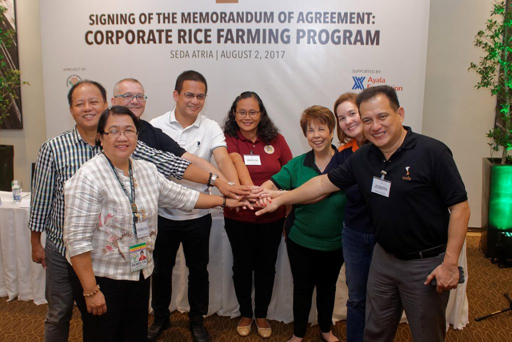 The signatories join hands in a show of unity and cooperation.