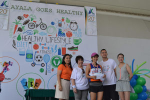 Leila Marie Santos of Ayala Land, the women's top placer, is shown after receiving her prize.