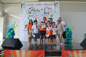 The family of Nerissa Abes of Globe Telecom and husband Jorge gets the top winner's prize in the family run.